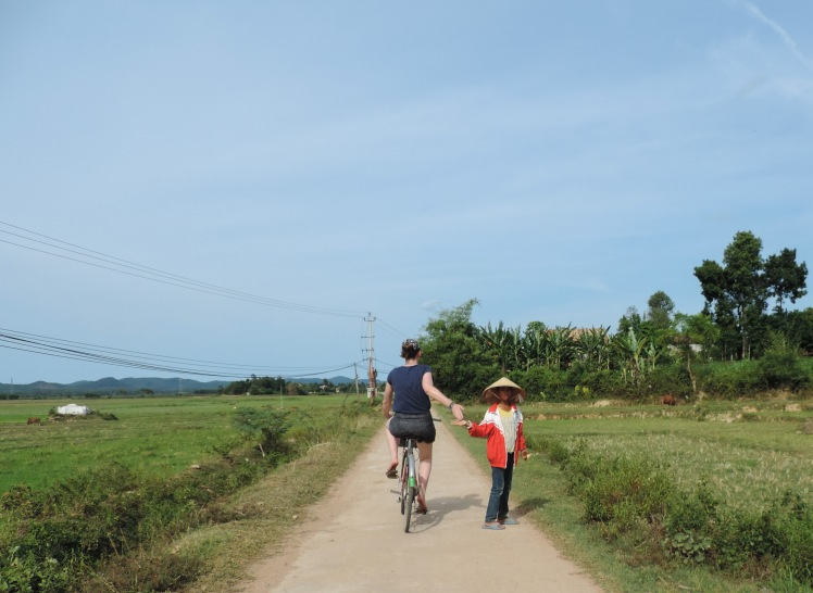 High Fiving Kids in Phong Nha