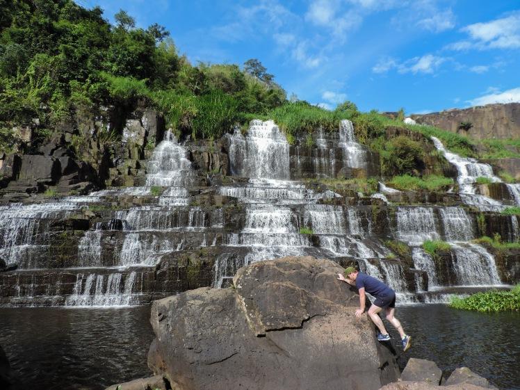 Tim climbing at Pongour Waterfall
